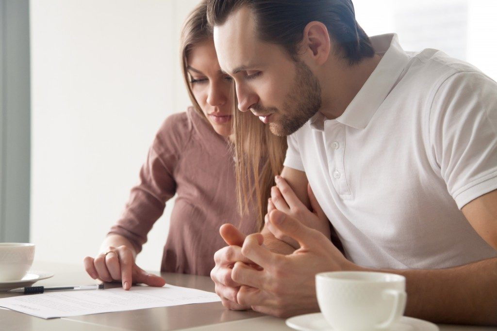 Couple reading mortgage insurance