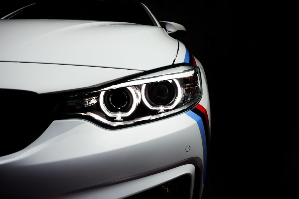 Headlight of a white sports car