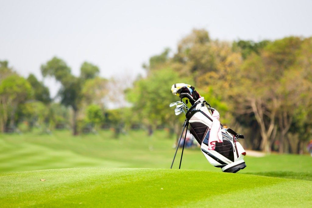 Golf clubs and bag in golf course