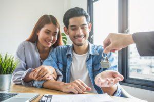 Couple receiving house keys