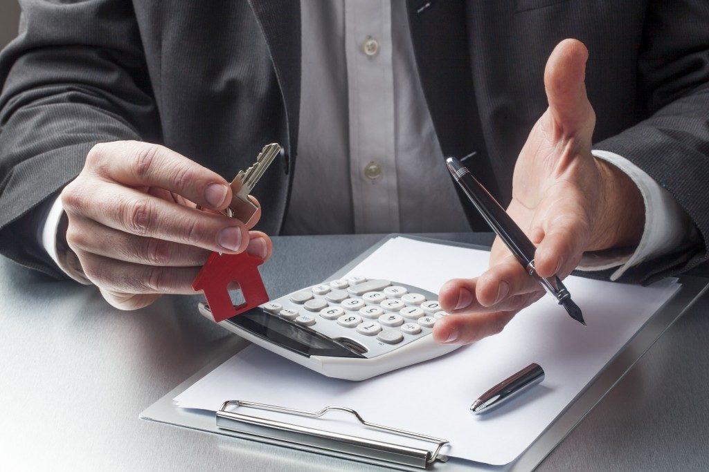 Agent holding house key