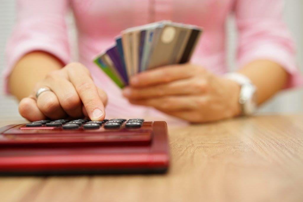 Woman computing her credit card debt