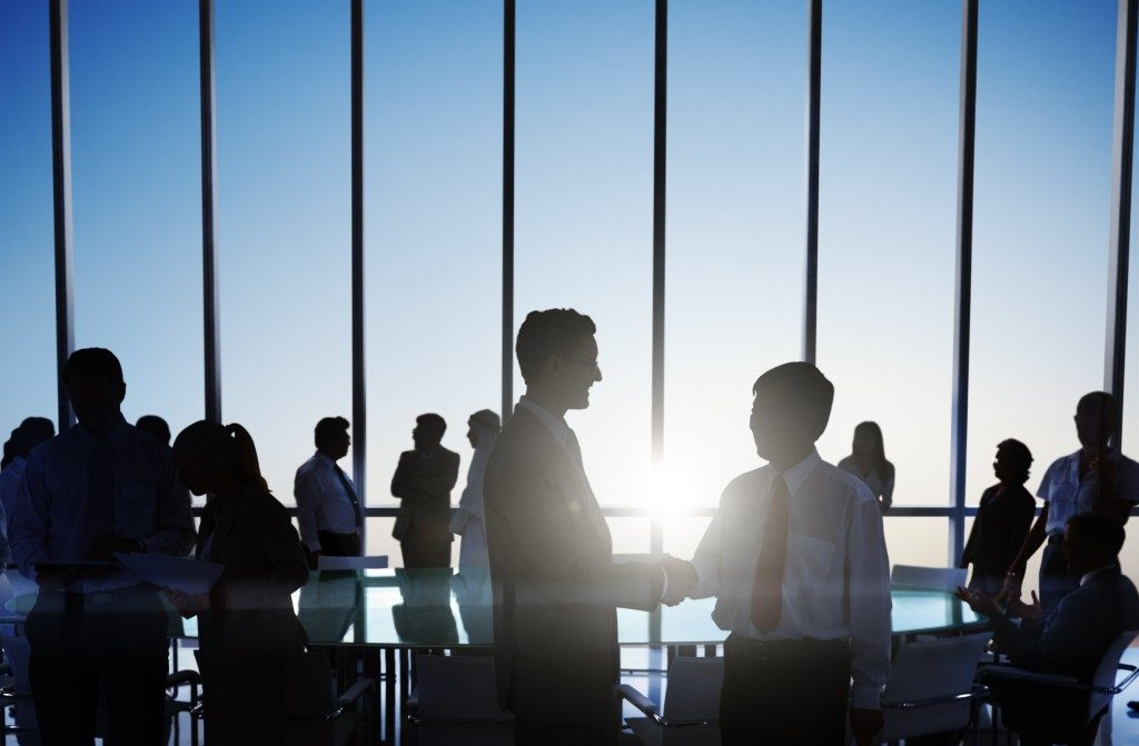 Global Business People Shaking Hands at Sunset