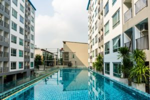 Swimming pool among high rise condo buildings