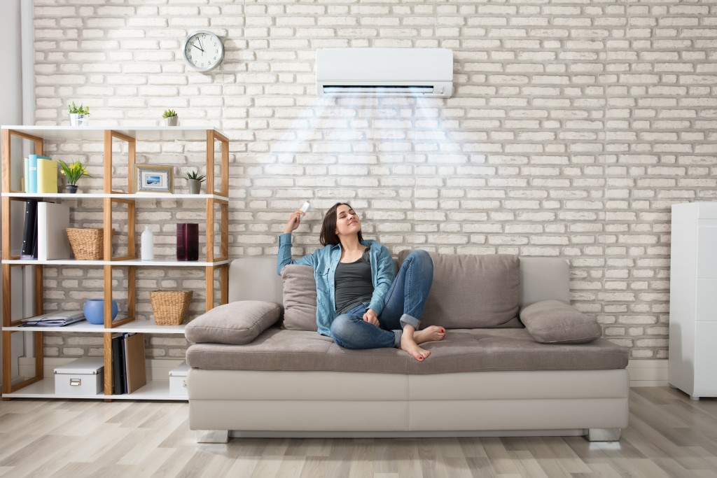 woman in the living room using airconditioner