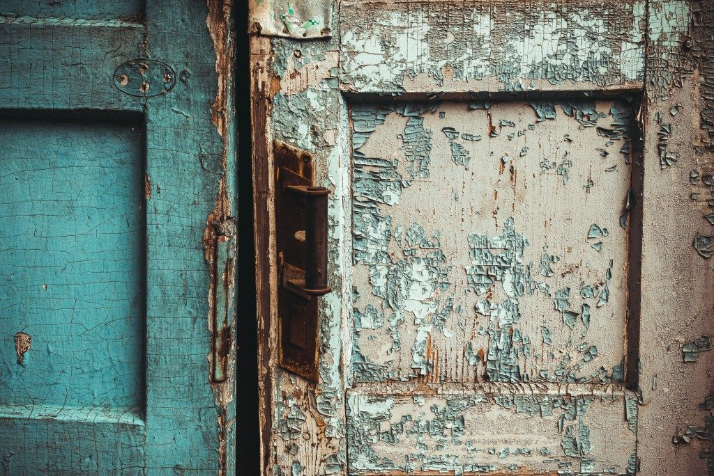 Old paint flaking of an old door