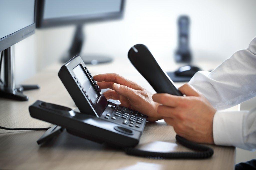 Man dialing phone