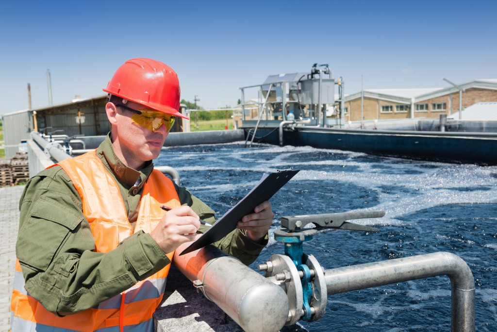 man at a facility conducting water tests