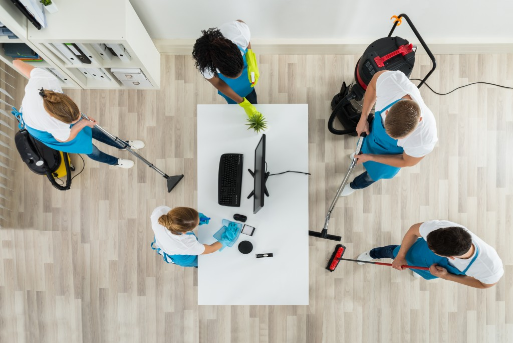 People cleaning an office