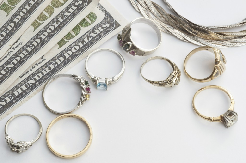 pawn shop concept with rings and money