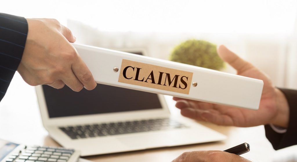person handling a claim book to a client