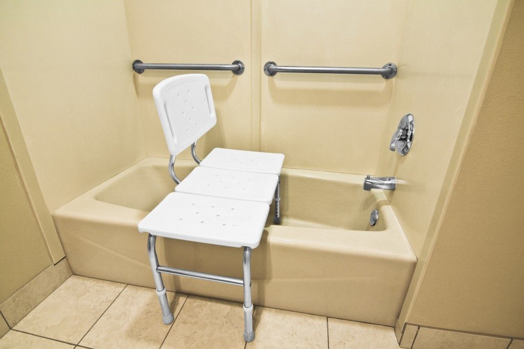 bathing chair and grab bar in the bathroom for elders
