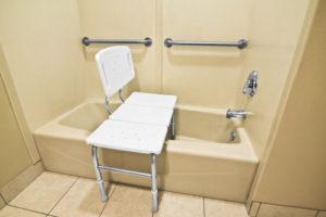 bathing chair and grab bar in the bathroom for elders
