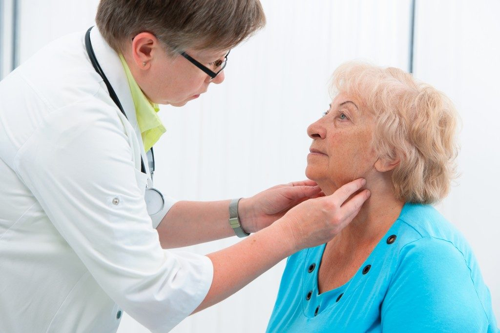old woman having her lymph nodes checked