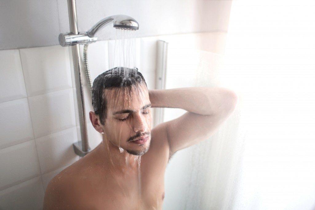 man taking hot shower