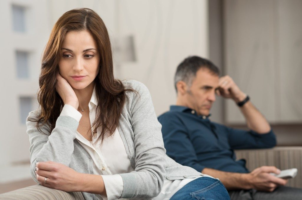 unhappy couple sitting on a couch