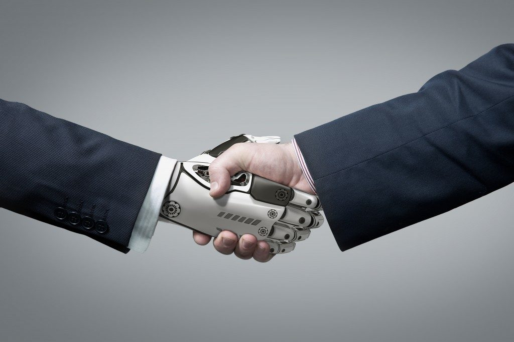 Handshake between robot and human concept