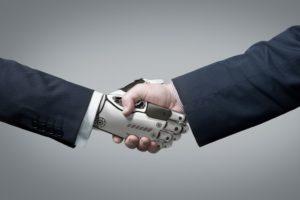 Handshake between robot and human concept