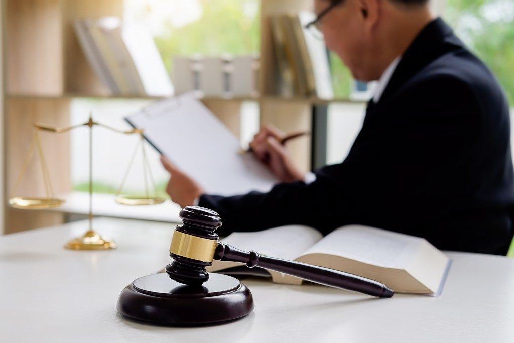 Lawyer reviewing a case in the background