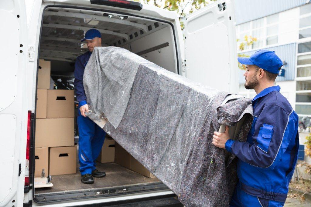 men placing things inside the van