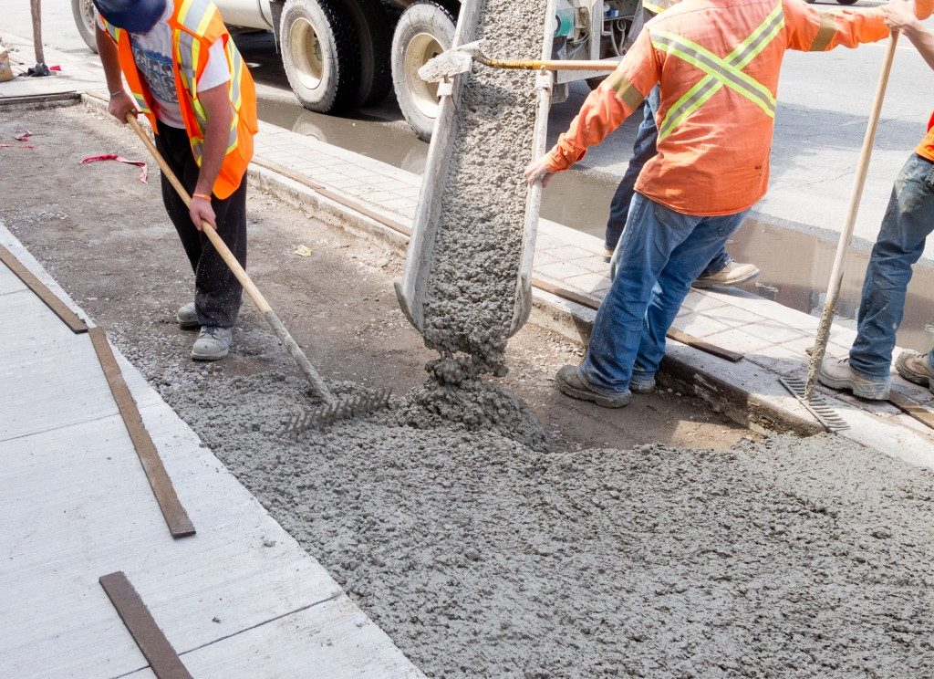 Workers pouring concrete cement mix