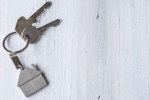house keys with a keychain of a house