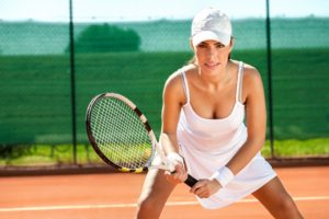 Female tennis player waiting for a service