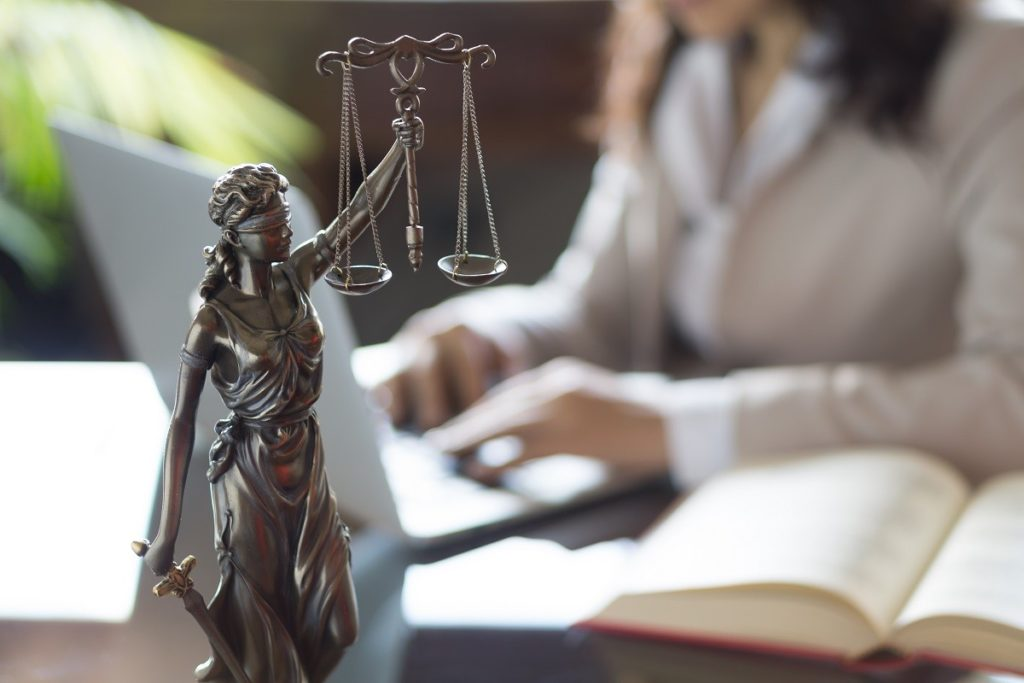 Law professional working with a statue on the table