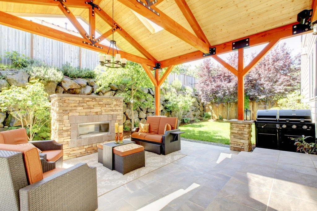 nicely decorated patio with furniture