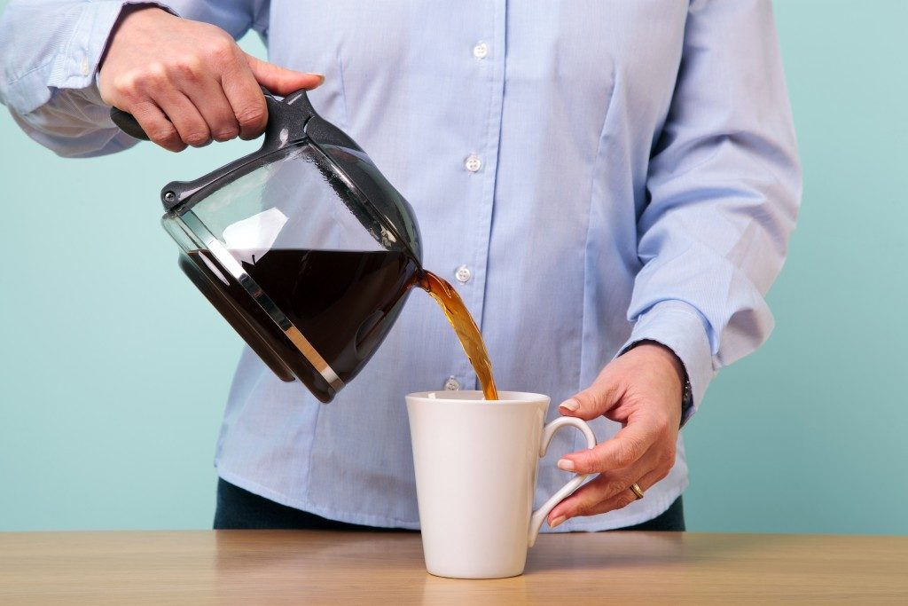 Pouring coffee into a mug