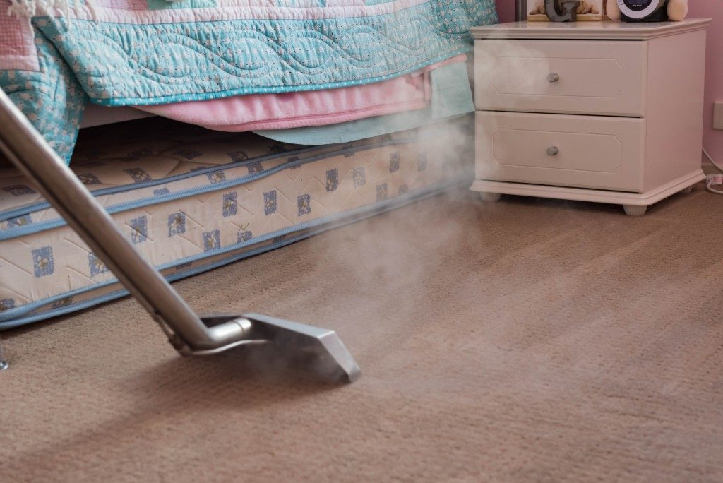 Cleaning the carpet in the bedroom