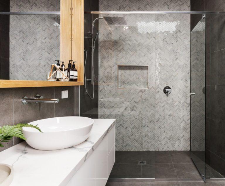 modern minimalist bathroom with grey walls