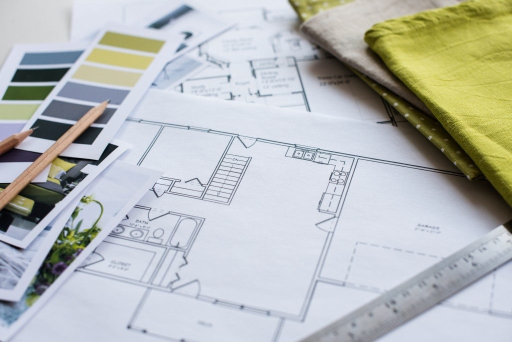 remodeling concept with floor plan, ruler, fabrics, color swatches and photos