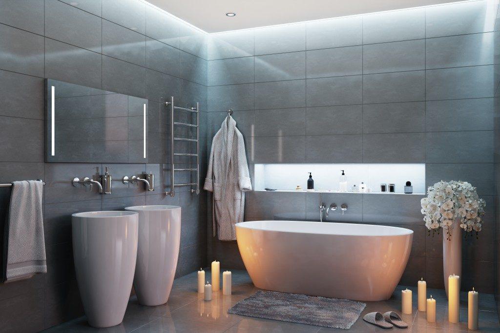 modern bathroom with bathtub and candles