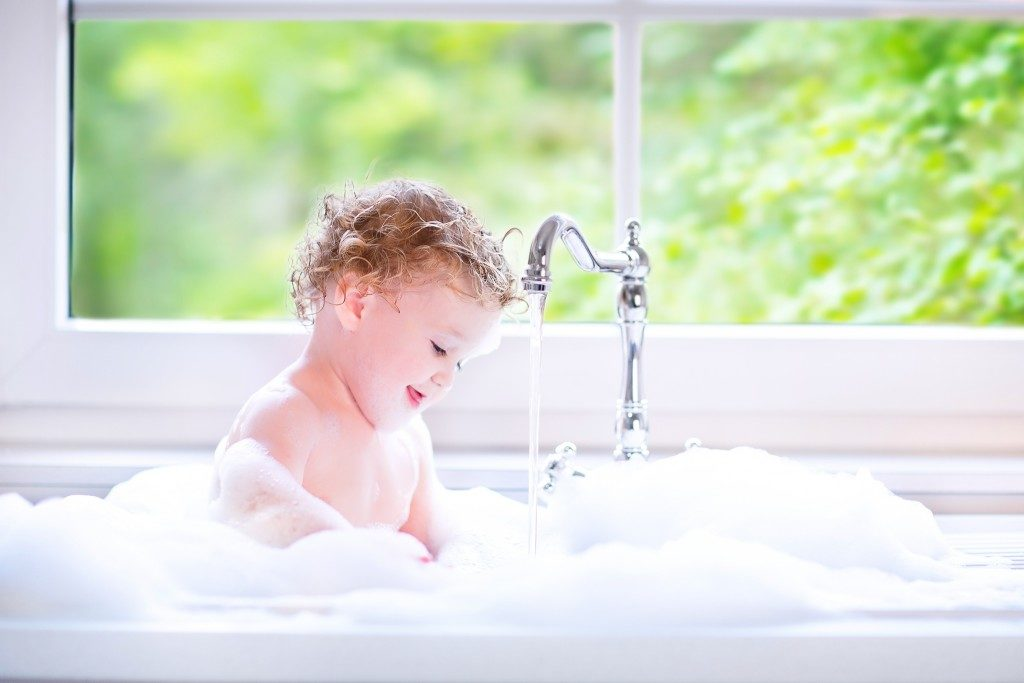 baby taking a bubble bath