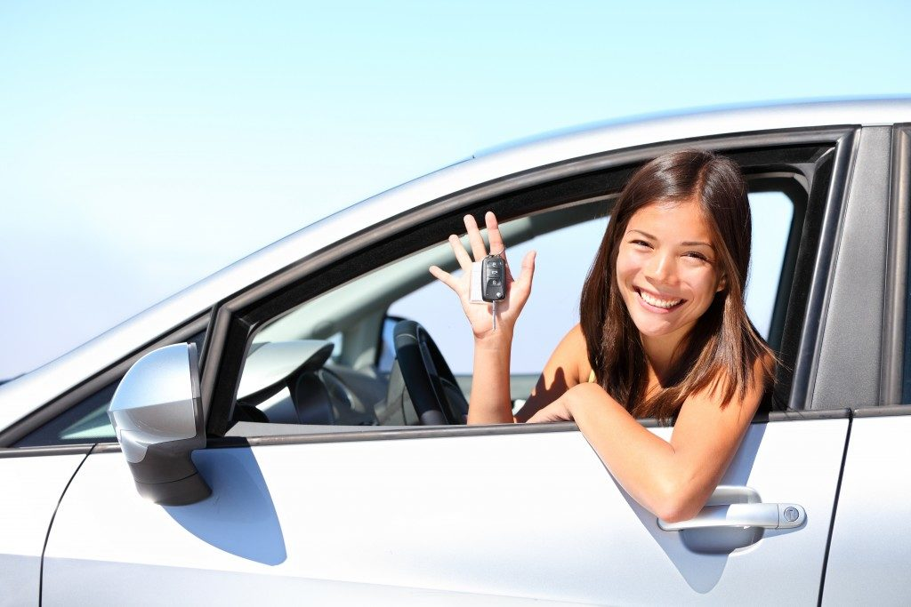 woman inside her newly bought car