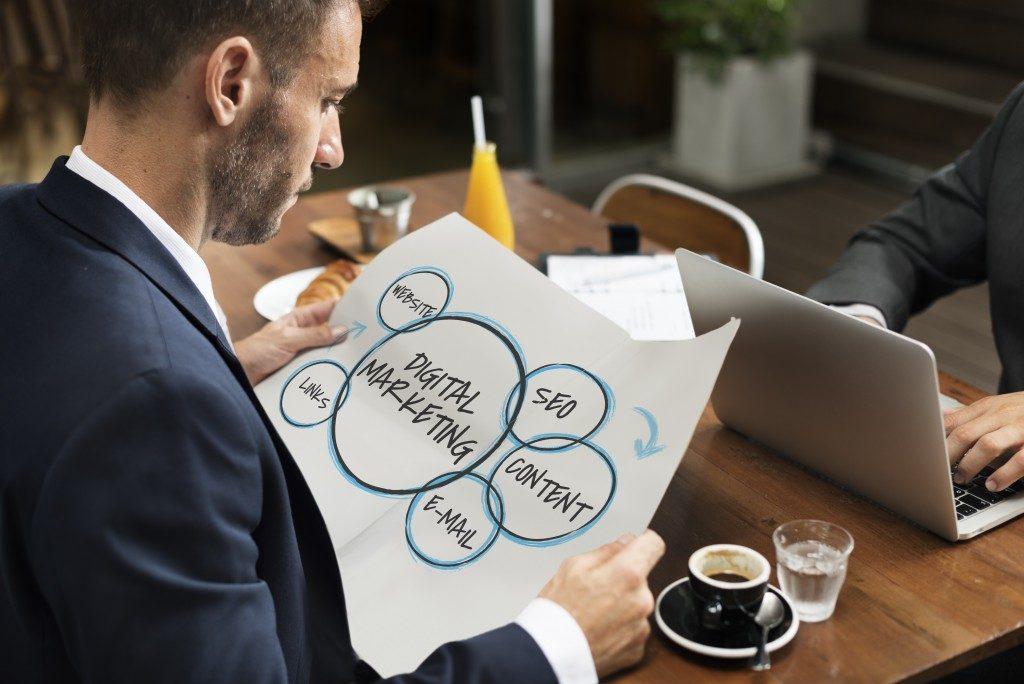 Man looking at a digital marketing plan