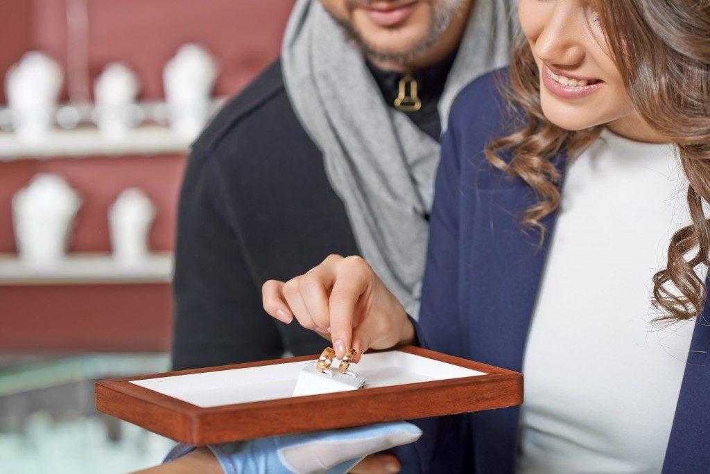 Couple choosing wedding rings