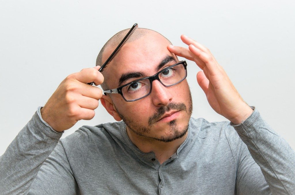 Bald man with comb