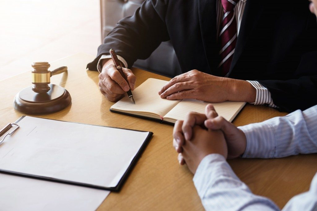 Client talking with lawyer