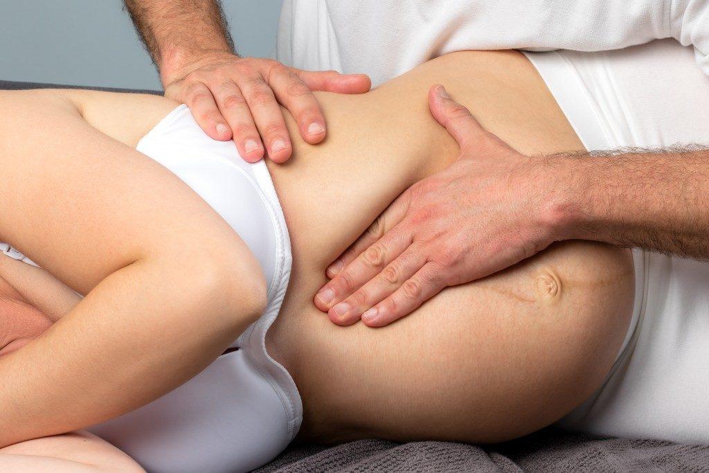 Chiropractor massaging a pregnant woman