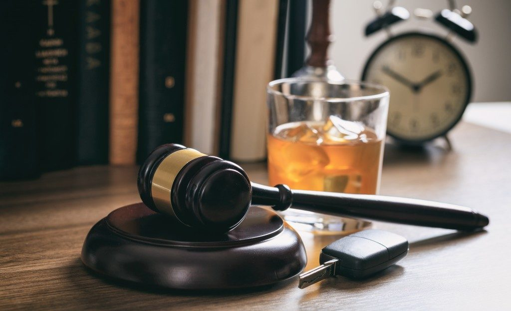Gavel and alcohol to symbolize intoxication defense
