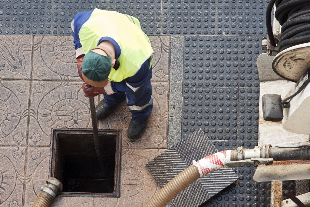 Worker fixing a portion a a sewer