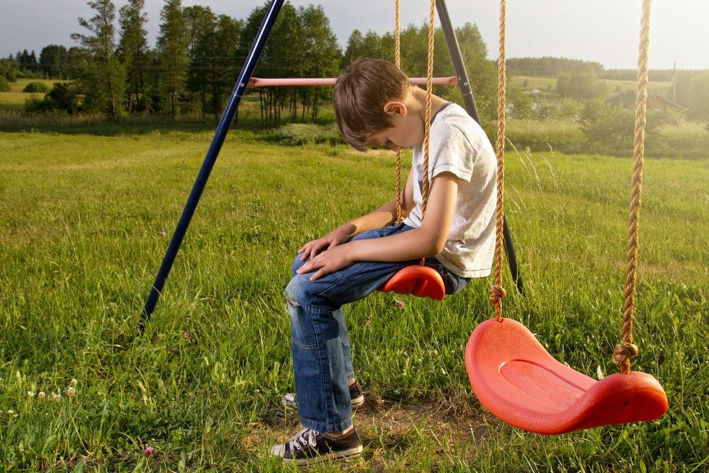 lonely child in a swing