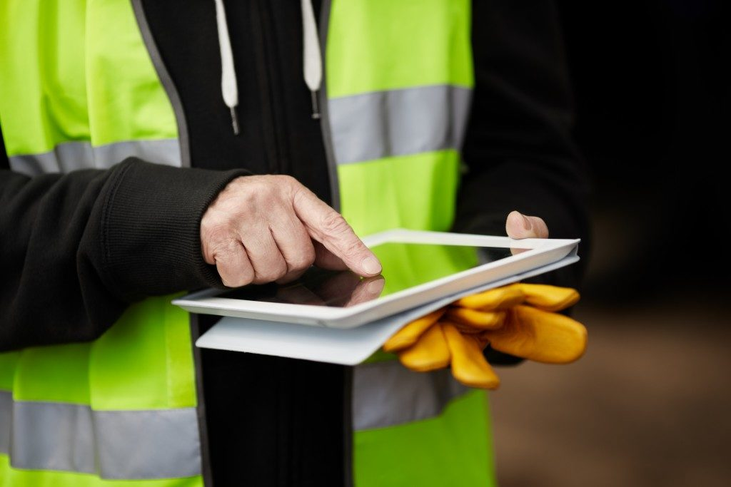 Construction worker holding a tablet
