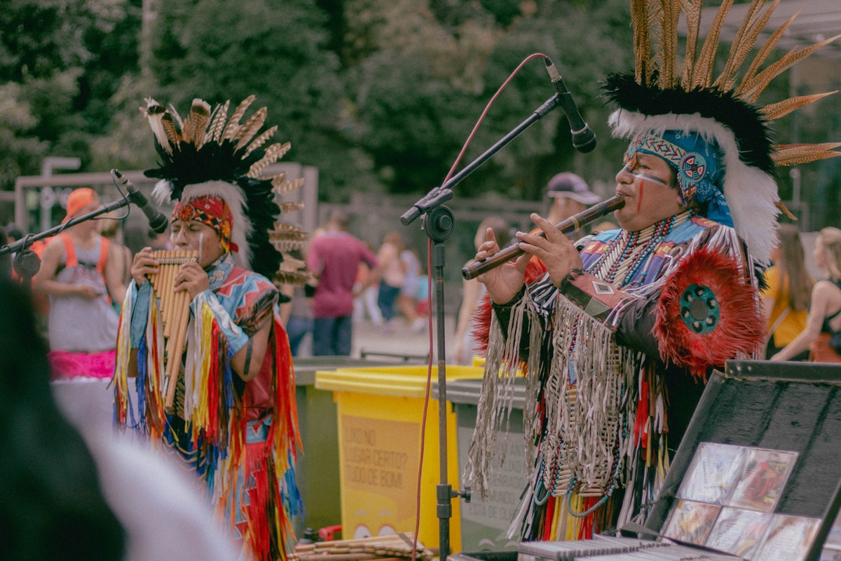 2 native american playing instruments