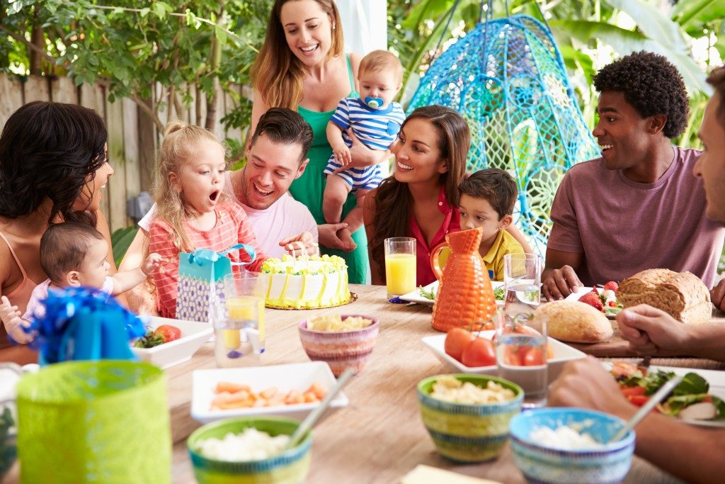 Families Celebrating Child's Birthday At Home
