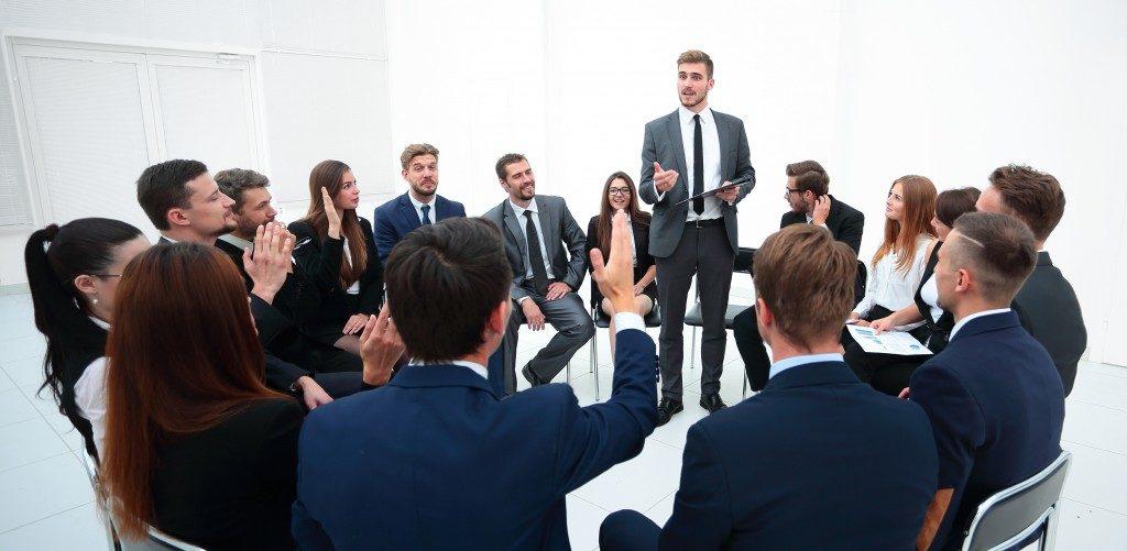 Seminar audience raising hands