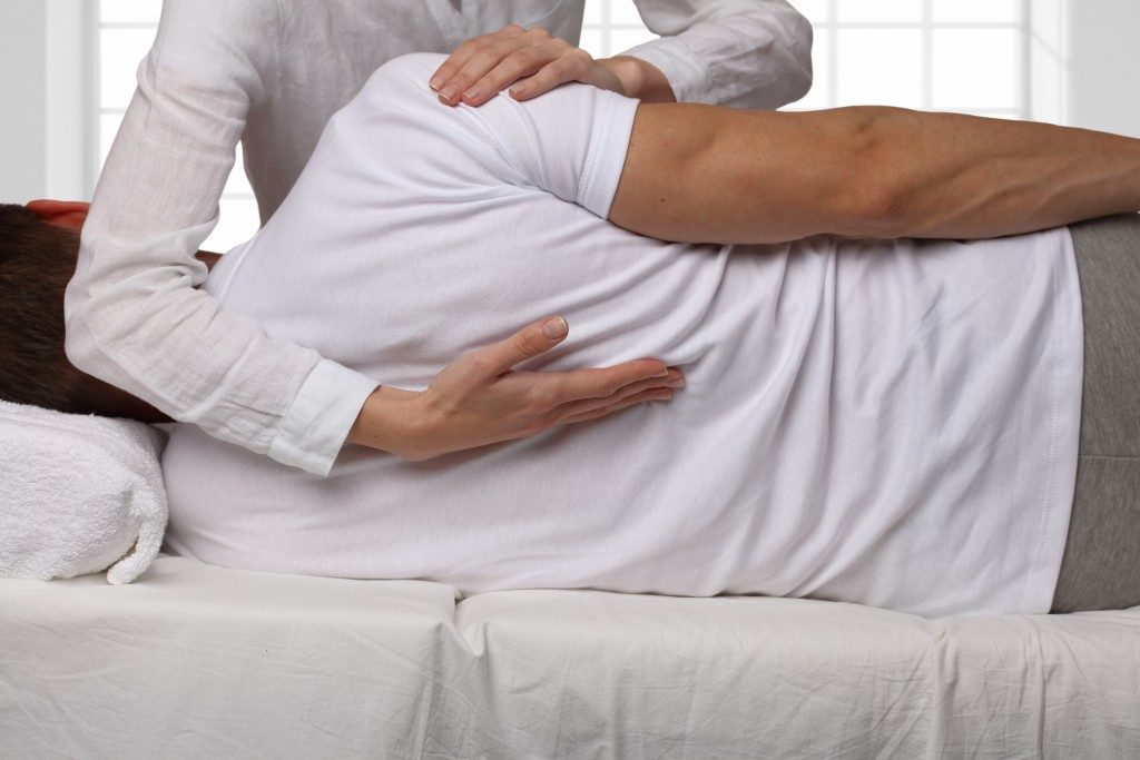 man undergoing chiropractic therapy