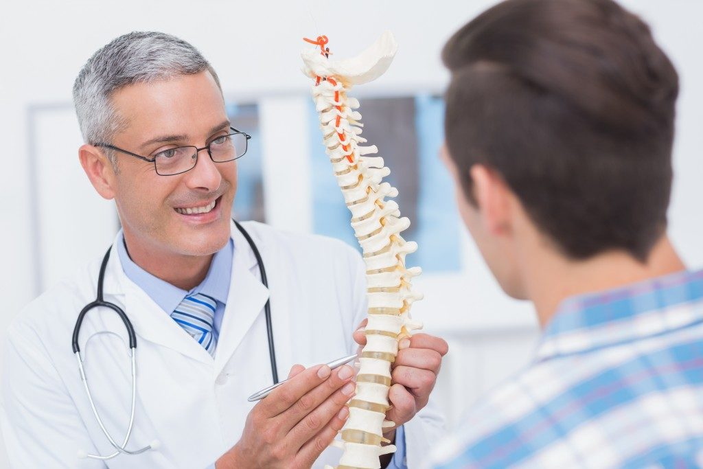 man talking to a chiropractor